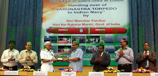 The Union Minister for Defence, Shri Manohar Parrikar handing over a model of 'Varunastra' torpedo to the Chief of Naval Staff, Admiral Sunil Lanba, at the Handing Over Ceremony of 'Varunastra' torpedo to Indian Navy, in New Delhi on June 29, 2016. The Defence Secretary, Shri G. Mohan Kumar, the Secretary (Defence Production), Shri A.K. Gupta, the Secretary, Department of Defence R&D and Director General, DRDO, Dr. S. Christopher, the Scientific Advisor to Raksha Mantri, Dr. G. Satheesh Reddy and the DG NS&M, Dr. S.C. Sati are also seen.